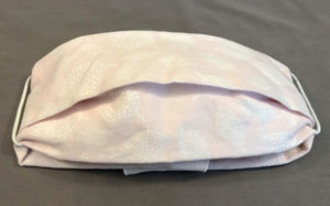 A cloth face mask made from a fabric napkin