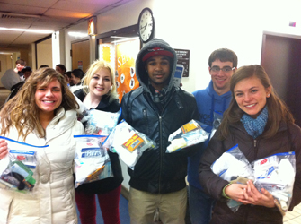 The students, of their own accord, packed blessing bags at IWU before coming to NYC to give out to the homeless during ministry.  These bags had tolietry items and socks.